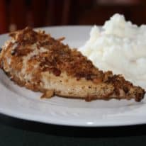 Crispy Onion Chicken on a white plate with mashed potatoes next to it