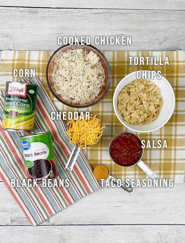 Ingredients for Mexican chicken casserole on a yellow plaid placemat