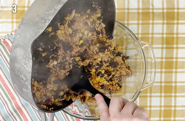 Transferring chicken mixture to a glass baking dish