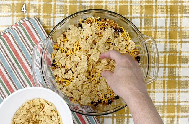 Topping casserole with crushed tortilla chips