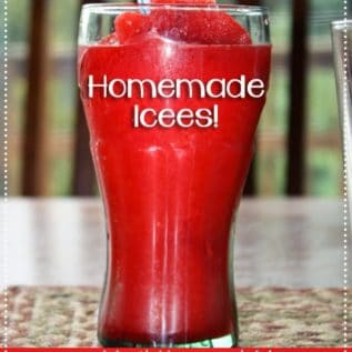 A red homemade icee in a glass with a straw