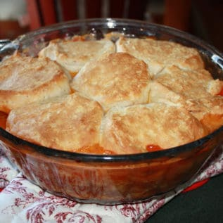 Cheeseburger biscuit bake in a glass baking dish on top of a green counter