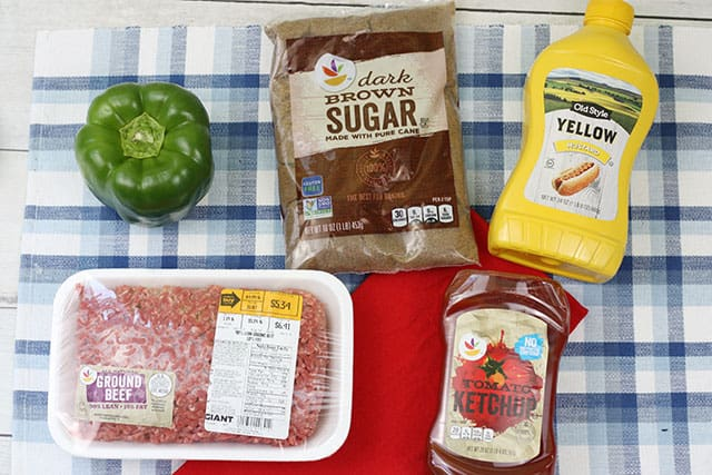 Ingredients for slow cooker sloppy joes on a blue plaid placemat