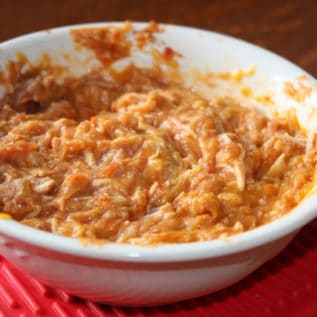 Nacho Chicken dip in a white bowl on a wood table