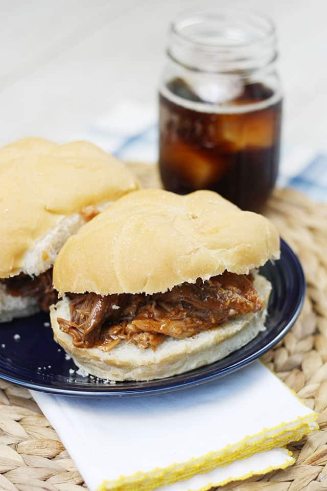 Root beer pulled pork sandwiches on a blue plate