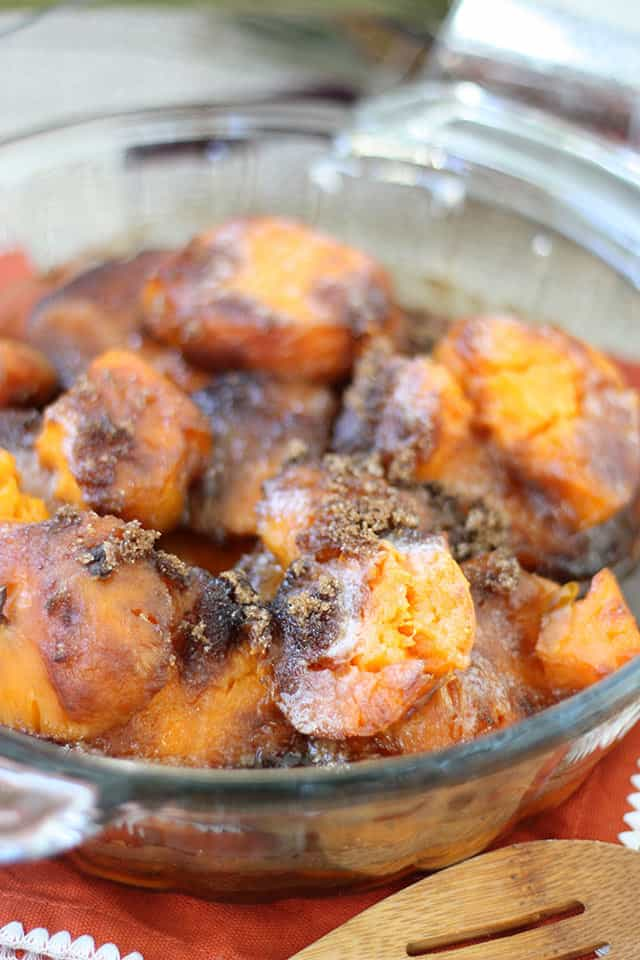 Cooked sweet potato casserole in a clear baking dish