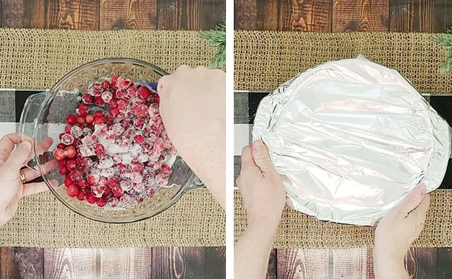 Fresh cranberries and sugar in a baking dish being covered with foil