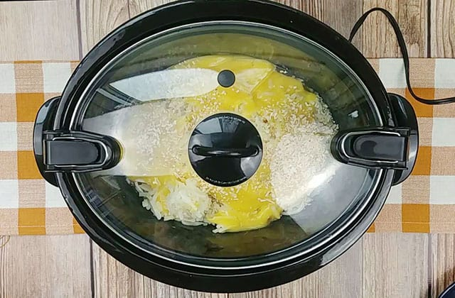 Crockpot baked potato soup cooking in a slow cooker