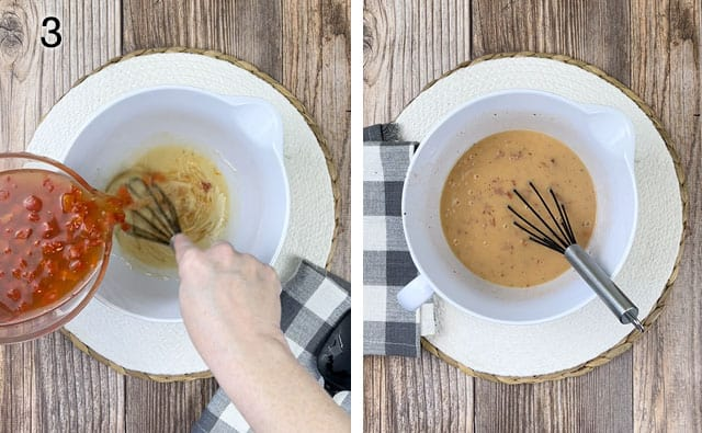 Whisking in hot soup to the roux in a white mixing bowl