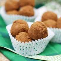 Irish Potato Candy in paper muffin liners on a green napkin