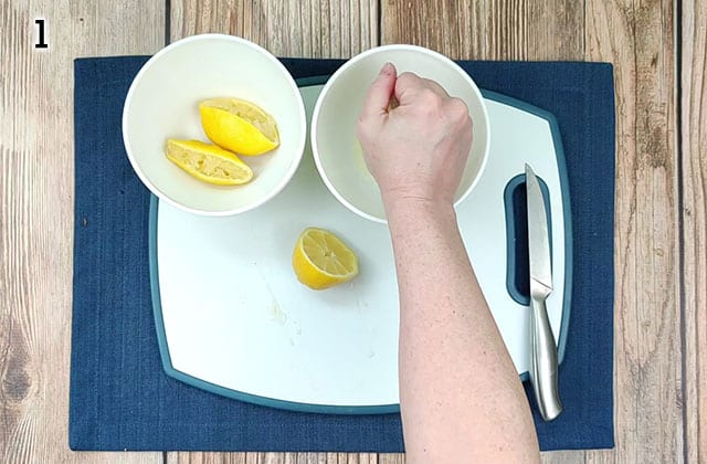 Slicing lemons in half and squeezing juice into a bowl