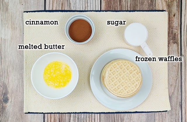 Ingredients for churro waffles on a yellow placemat