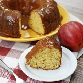 Cake Mix Caramel Apple Cake on a serving plate with a slice in front