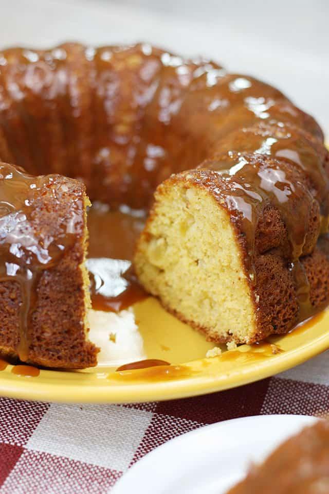Caramel apple cake on a yellow serving platter