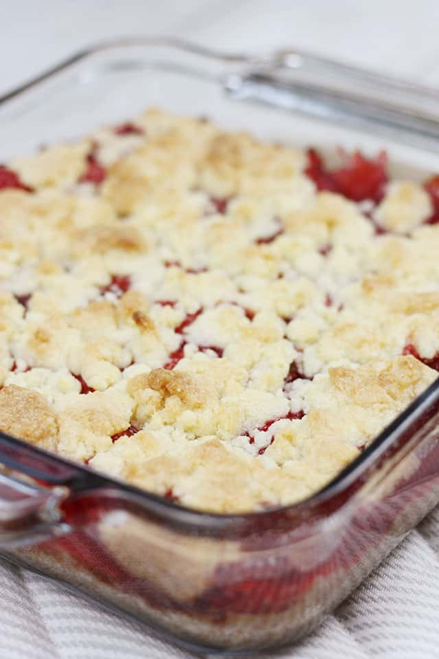 Cherry pie sugar cookie bars baked in a glass dish