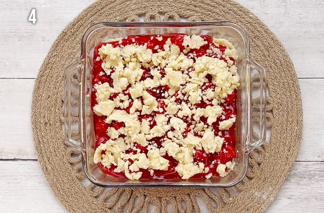 Finished cherry pie sugar cookie bars in a baking dish ready to be baked