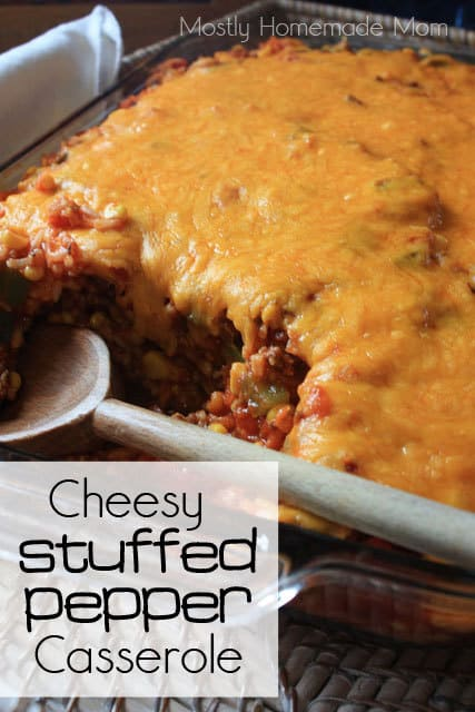 Stuffed pepper casserole in a dish with a wooden spoon