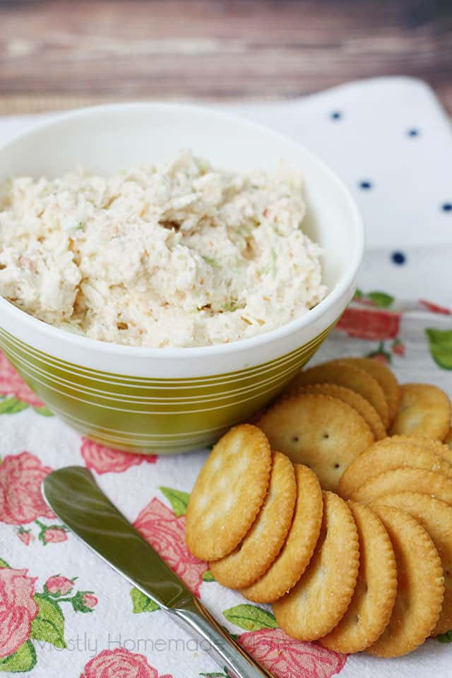Shrimp Dip in a bowl next to crackers and a spreading knife