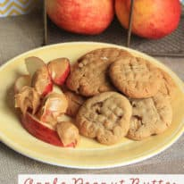 A plate with apple cookies, apple slices, and peanut butter being served