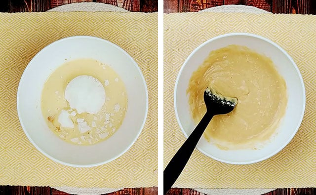 Adding baking mix and sugar to pancake batter in a white bowl with a black spatula