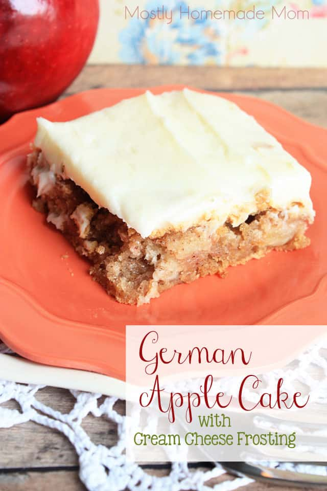 A slice of German Apple Cake on a plate with a fork