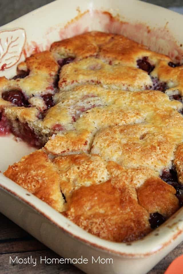 Cherry Buckle Cake in a baking dish with a slice taken out