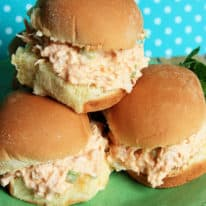 Buffalo chicken salad on hawaiian rolls stacked on a plate