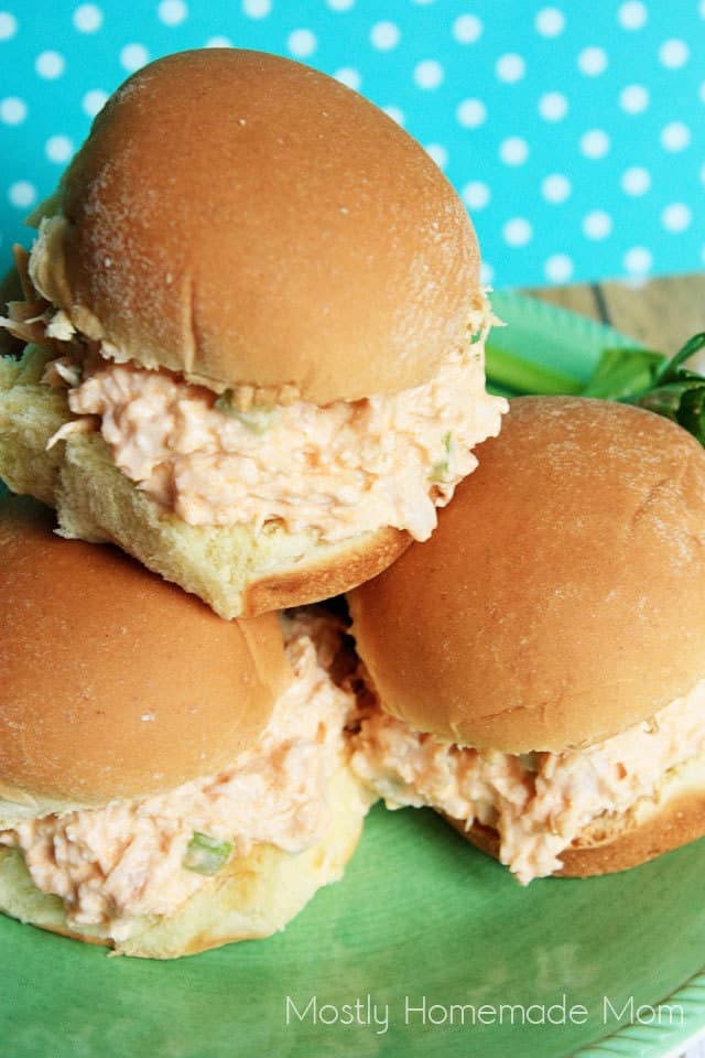 Three buffalo chicken salad sandwiches on a plate