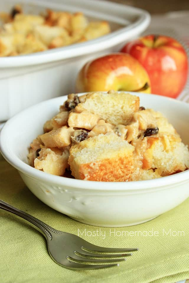 Apple french toast casserole in a white bowl on a green napkin