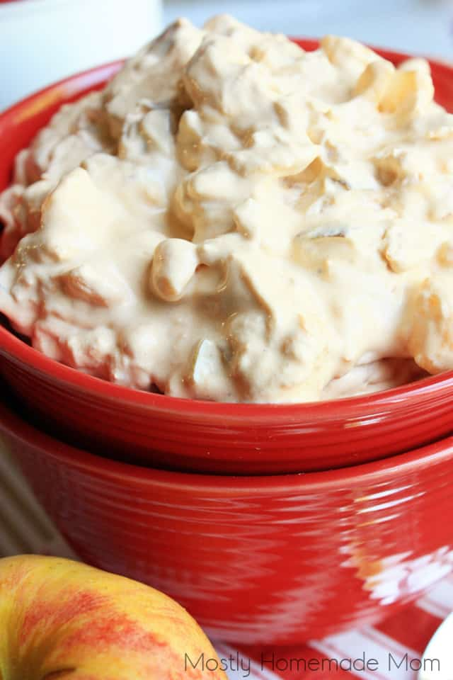 Apple butterscotch fluff salad in a red bowl