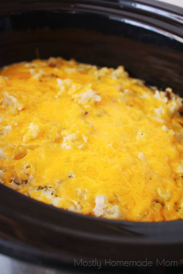 Slow cooker breakfast in a Crockpot with melted cheese