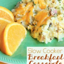 A piece of slow cooker breakfast casserole on a green plate next to some orange slices