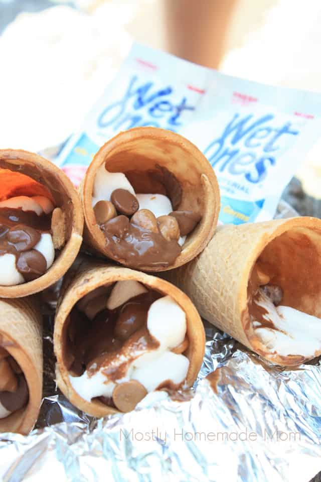 Peanut Butter Cup Smores in ice cream cones over the campfire