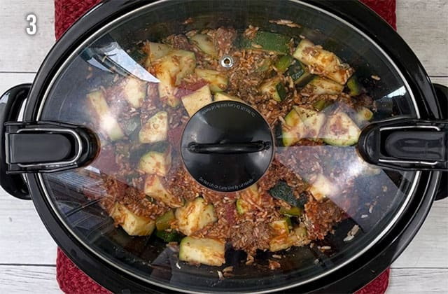Crockpot zucchini casserole in a slow cooker with the lid
