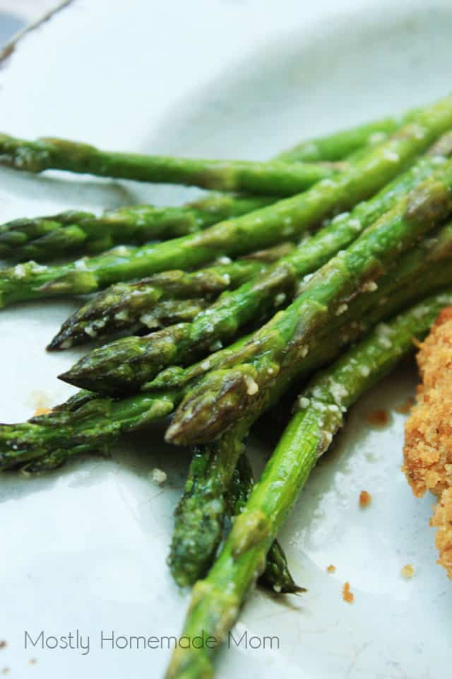 Asparagus tips on a white plate