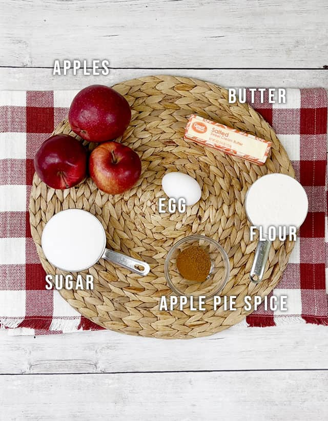 Ingredients for apple pie cake on a wicker placemat