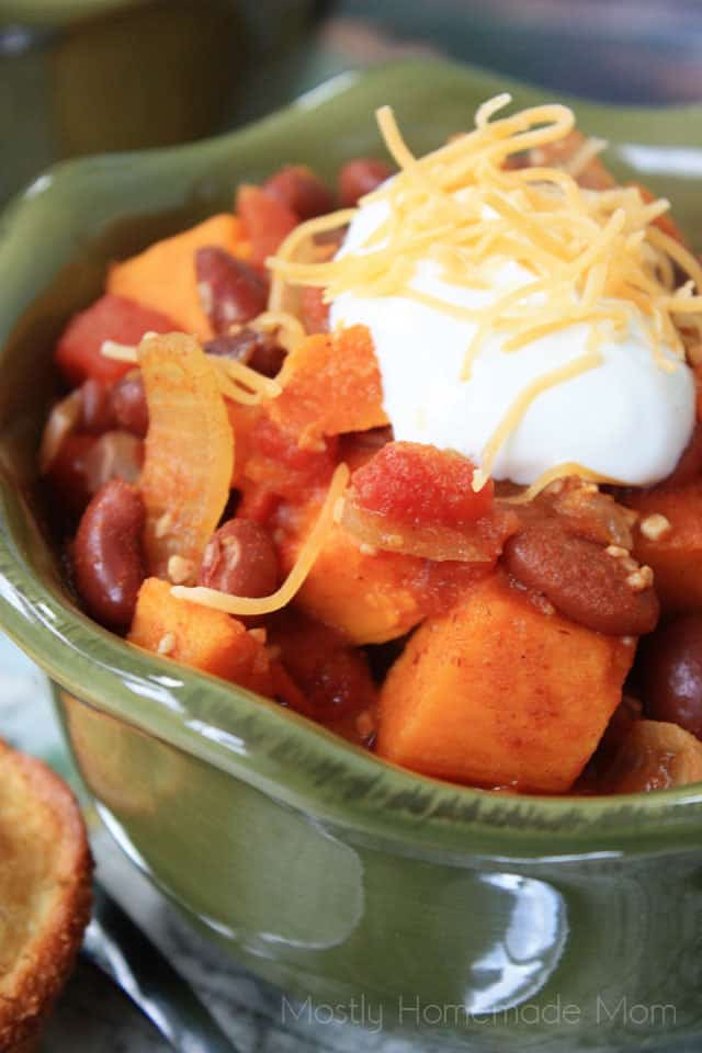 Close up picture of sweet potato chili topped with sour cream and cheese