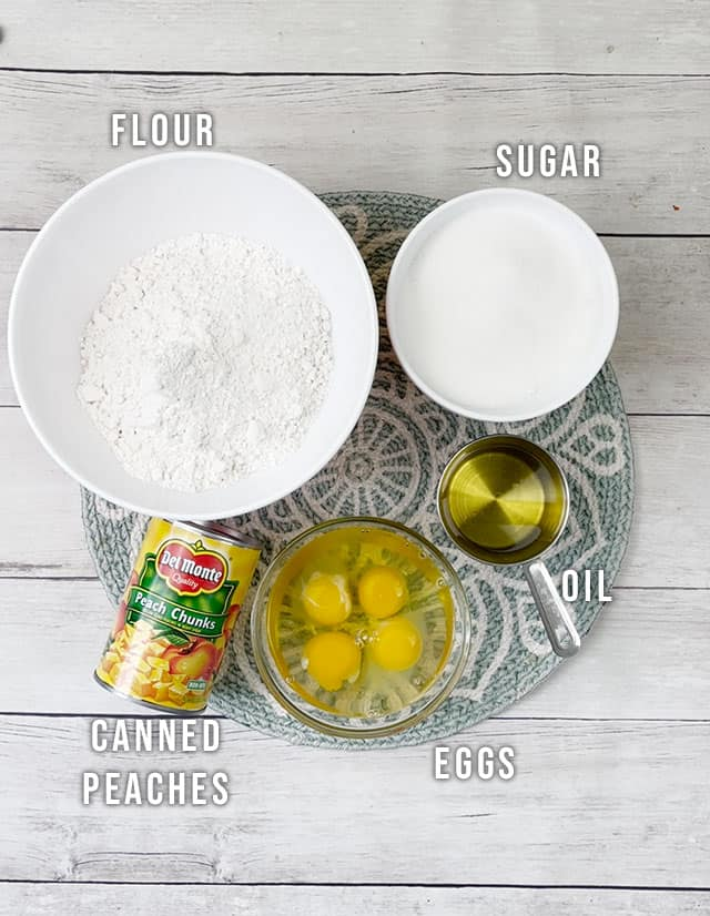 Peach cobbler bread ingredients on a placemat