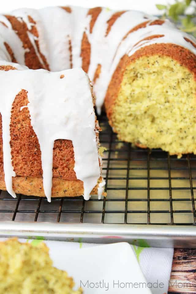 Lemon poppy seed pound cake with glaze on a wire rack