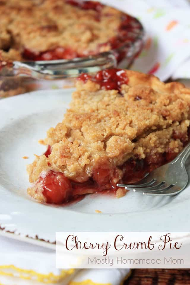 A slice of cherry crumb pie on a white plate