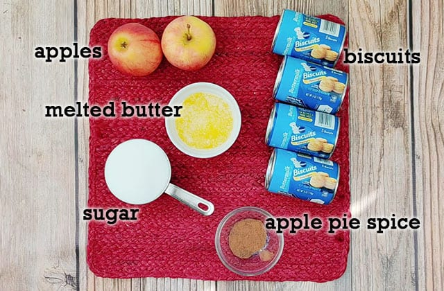 Ingredients for apple pie monkey bread on a red placemat