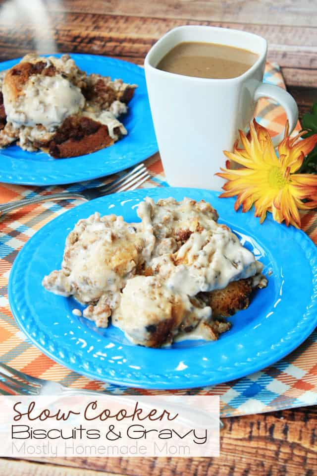 Slow cooker biscuits and gravy on a blue plate in front of a cup of coffee