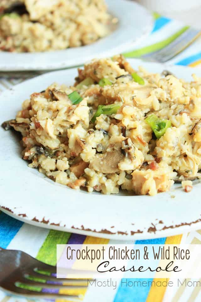 Chicken and wild rice casserole on a white plate with green onion garnish