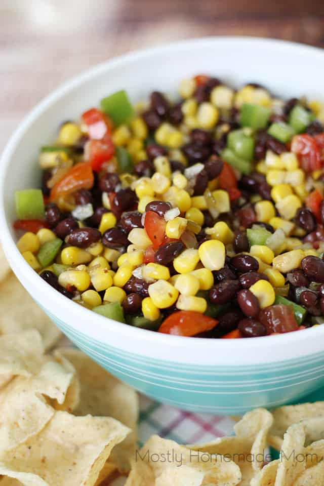Close up of corn and black bean salad surrounded with tortilla chips