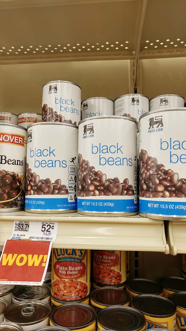 cans of black beans on a grocery store shelf