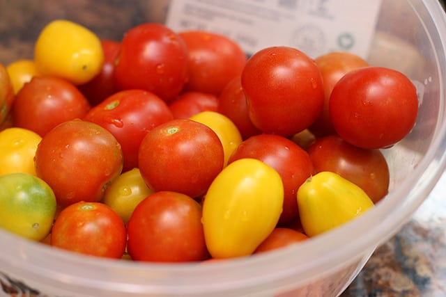 Red and yellow cherry tomatoes in a bowl