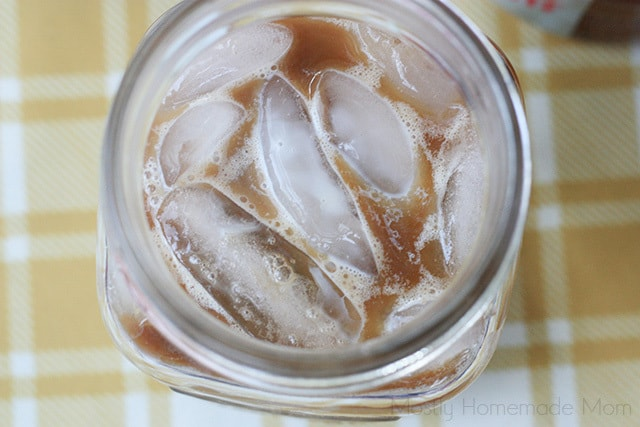 Coffee and creamer with ice in a mason jar