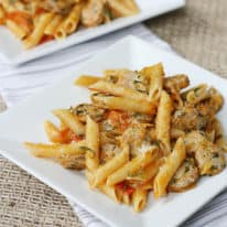 Chicken sausage pasta on a white plate being served