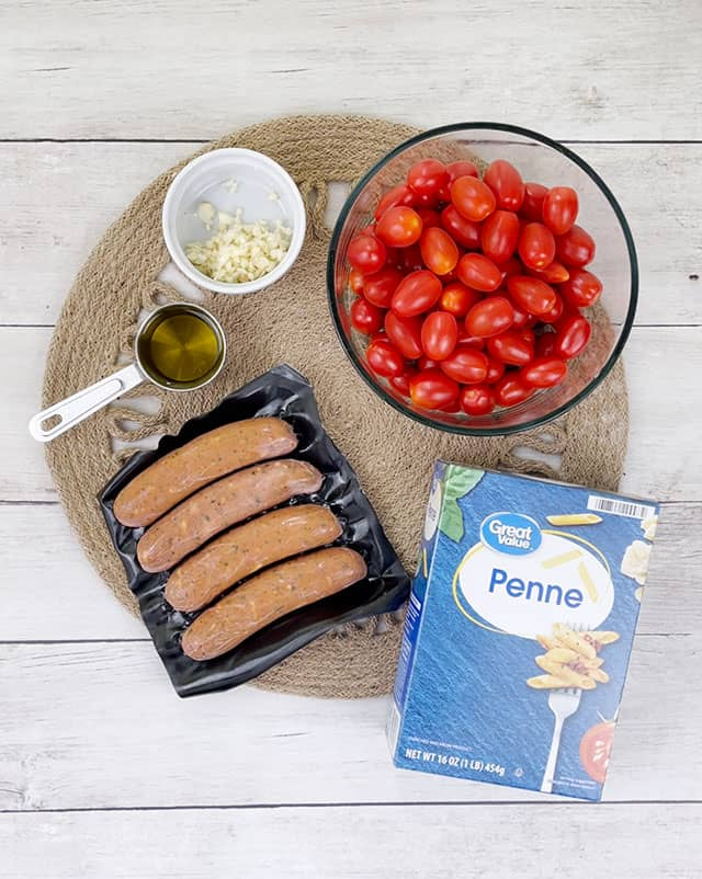 Ingredients for chicken sausage pasta on a placemat
