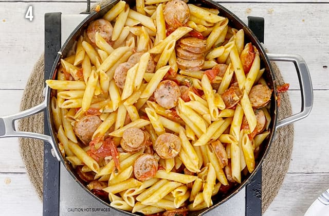 Finished chicken sausage pasta in a skillet on the stove
